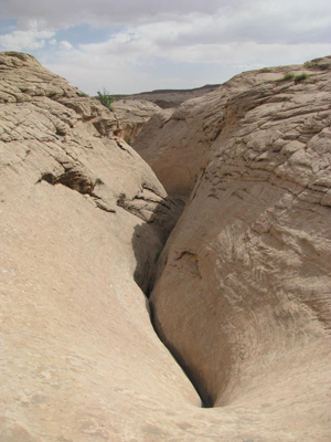 A Crevice or Canyon has Shade in the Desert